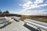 The deck with a grill, sitting area, and beautiful views of Crescent Surf Beach